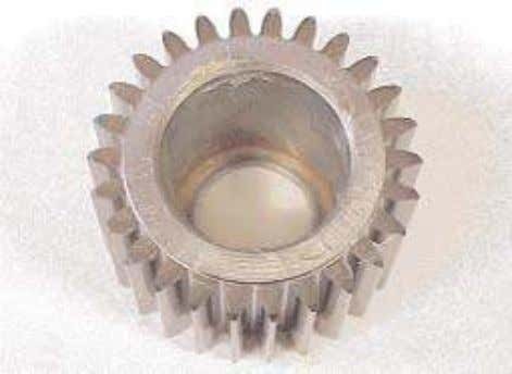 thrust washer, grooved face up, and one him on a flat plate. 2. Place the gear