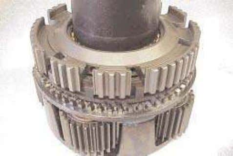 specified. Lubricate the synchronizer ring and flange. 9. Place the synchronizer hub and bearing assembly onto