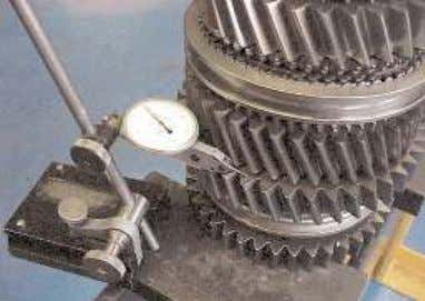 with the shaft assembled by using a dial gauge as shown. 1. Mount the mainshaft assembly
