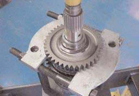 5. Invert the mainshaft assembly in the press and using suitable puller plates, under the
