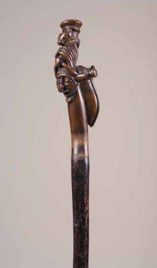 Composite staff , late 19th to early 20th century. Wood and leather. Karel Nel collection. VISU