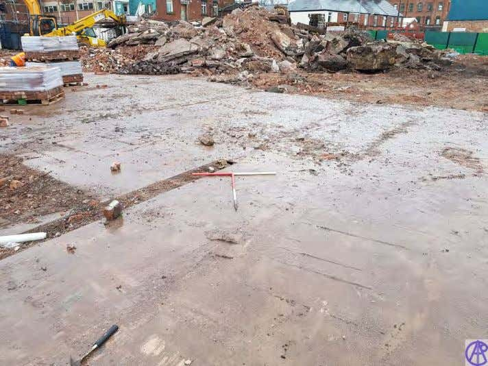 Portland Mill, Leek Plate 1: View of ground slab in situ prior to removal. Scales 1x1m,