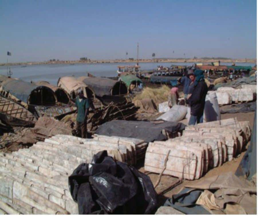 20 | From Timbuktu to the Mississippi Delta Boats on the Niger River unloading blocks of