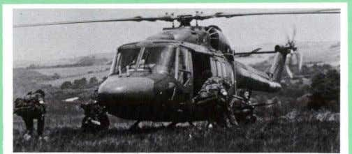 "requires one-quarter moon or better. The weights, com- 8 Troops deplani""g from a British Army Lynx"