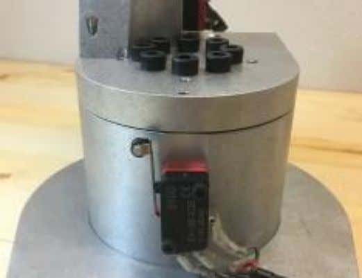the flat surface with 2 holes is facing toward the back. Mount J1 limit switch to