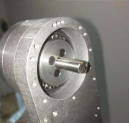 Install J3 spindle retainer. Secure with (4) M3 x 10 flat head screws. Tension screws