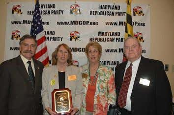 Maryland, accepts the Grassroots Activist of the Year Award. Worcester County Republicans , including Chair Marty