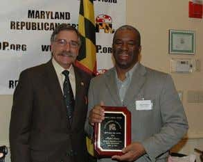 Year Award, photographed with Patt Parker, MFRW President. Prince George's County Chairman Mykel Harris accepts the