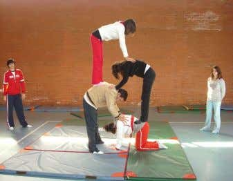 it provides a base of gymnastics, including learning elements like somersaults, inverted balances and jumps on