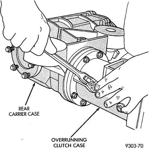 (5) Remove overrunning clutch case to rear carrier bolts (Fig. 14). Fig. 14 Overrunning Clutch Case
