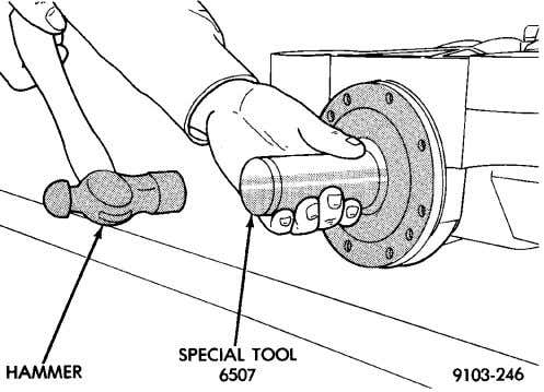 the spring side in towards the rear carrier case (Fig. 34). Fig. 34 Input Seal Installation