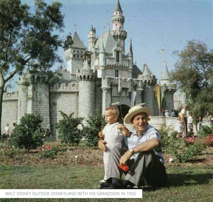 WALT DISNEY OUTSIDE DISNEYLAND WITH HIS GRANDSON IN 1955